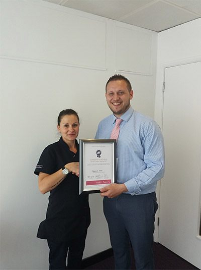 Image shows Adrienne receiving her award certificate from NJC Portfolio Manager, Charles Walden